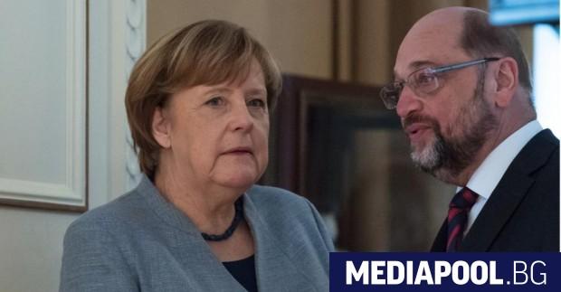 Ангела Меркел и лидерът на ГСДП Мартин Шулц Високопоставени лидери