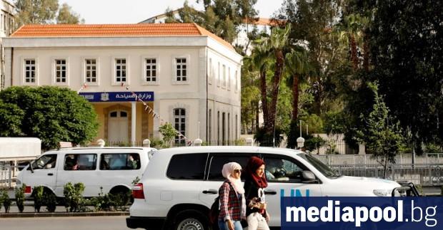 Кола на инспекторите на ОЗОХ, заснета в Дамаск във вторник