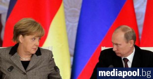 Ангела Меркел и Владимир Путин Германската канцлерка Ангела Меркел каза,