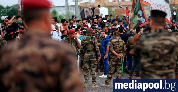 Маскирани въоръжени мъже нападнаха иракски демонстранти в южния град Басра