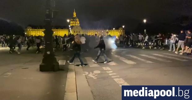 Масов купон на открито в Париж приключи със сблъсъци с